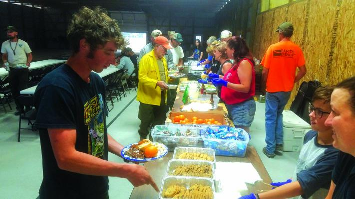 More than a dozen Ennis community members volunteered to make and serve dinner to members of the Southern California Interagency Incident Management Team (SCIIMT) August 13, when it was discovered their catering truck wouldn't arrive until the next night. (Photos courtesy of Terri James)