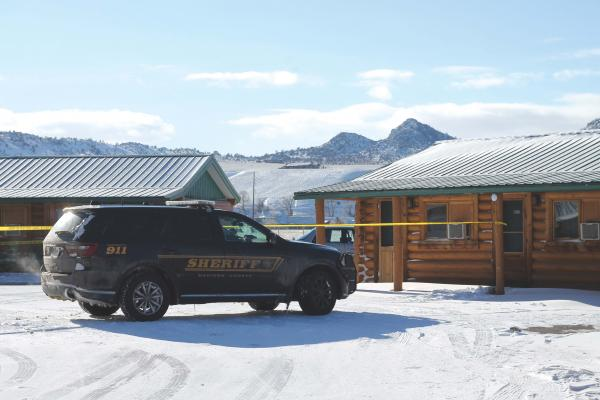 Crime scene tape surrounds the site of an early Monday morning shooting in Ennis.  Madison County Sheriff's Department and the Ennis Volunteer Ambulance received a 911 call and responded to the Sportsman's Lodge after the Feb. 19 shooting. (C. AVEY PHOTO)