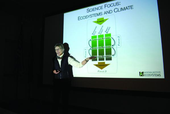 Dr. Cathy Whitlock, a professor of Earth Sciences at Montana State University (MSU), and a fellow with the Montana Institute on Ecosystems told a packed Ennis fire station that warming due to climate change is already here on Wednesday, Nov. 28. (J. Taylor)
