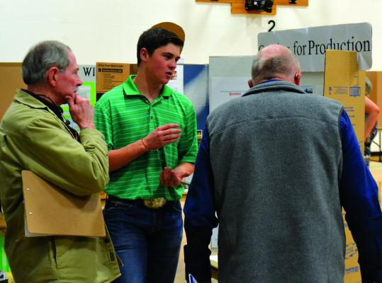 Chance Story answers questions about his science fair project, which examined the effects of intensive grazing on forage growth on local ranches. Story earned third place in the 10th grade biological sciences category for his research, as well as a $75 award from the Madison Conservation District. (R. Colyer)