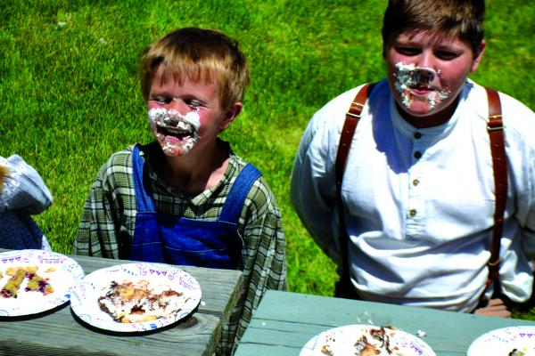 Two young volunteers at the Nevada City Museum display the remnants of a successful pie eating contest on Saturday, June 30.