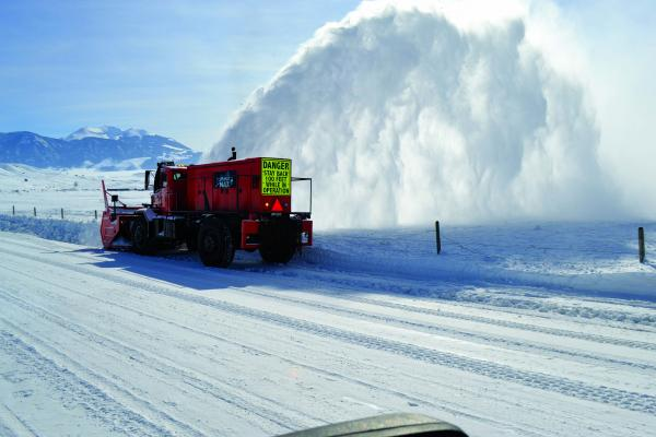 A snow plume shoots from Mad Max the snow blower as it clears Jeffers Loop Road. The blower has 650 horsepower just in the rotor along its front, which is used to slice through drifted and packed snow.