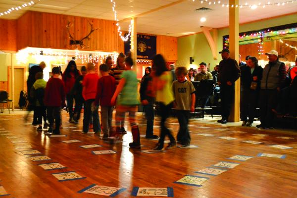 The kickoff event for the cakewalk was a cupcake walk for kids. As music played, the kids marched around squares pasted to the floor. When the music stopped and winning number was called it earned a cupcake for the lucky boy or girl.