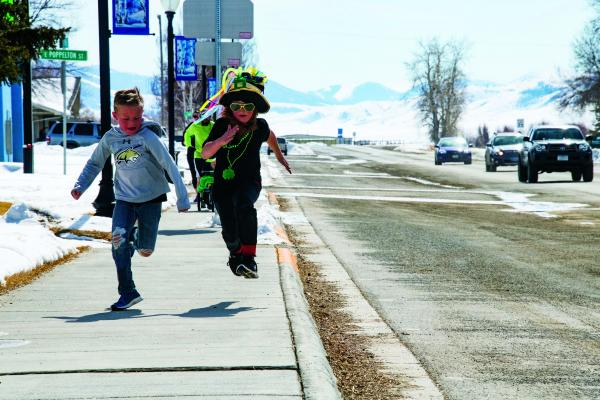 Young competitors in Sheridan's 2019 Leprechaun Dash race down Main Street toward the finish line on Saturday, March 16. (Photos courtesy of Christina McRae-Holland)