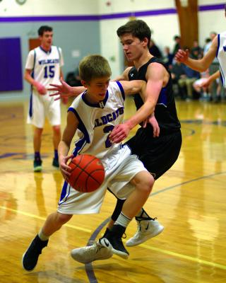 Harrison's Dillon Christiansen makes a drive for the basket against Sheridan on Saturday, December 15. The Wildcats defeated the Panthers, keeping Sheridan winless so far this season. (A. Christensen)