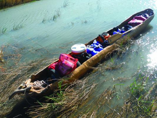 Paddling the Missouri in 2014 in a dugout canoe.