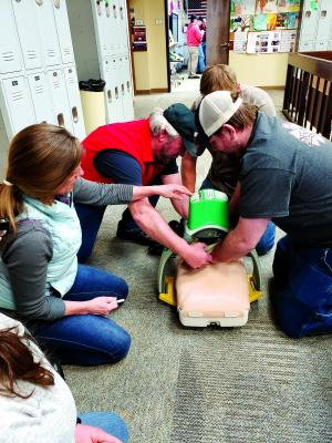 Ennis Ambulance and Madison Valley Rural Fire Department responders practice CPR on a mannequin with a mechanical Lucas device, to provides high quality CPR with constant and consistent profusion.