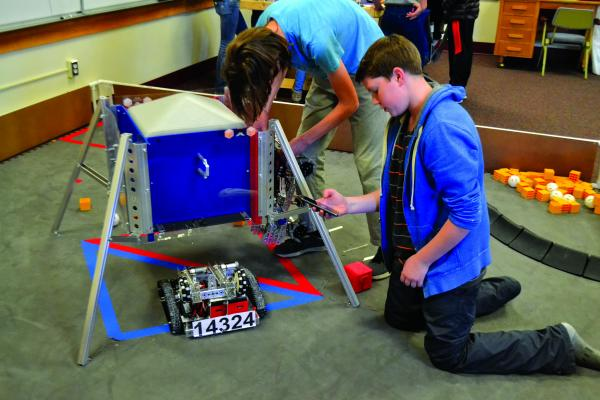 Brothers CJ (left) and Ethan Wayland, a junior and a freshman respectively, make up two of the 14 members of the Twin Bridges robotics team, which will make a bid for a Super Regionals berth in February when they compete at Montana State University. (R. Colyer photos)