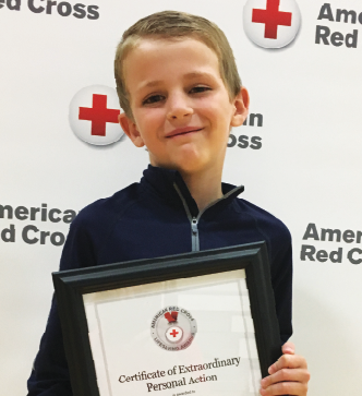 Parker Walter with his Red Cross Lifesaving Award. PHOTO SUBMITTED BY Matt Ochsner