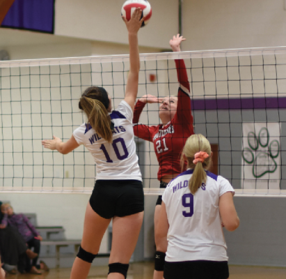 Wildcats junior Aleena Bacon, #10, reaches for a spike against the West Yellowstone Wolverines during the volleyball game in Sheridan Oct. 1.   Photo credit Andrea Christensen.