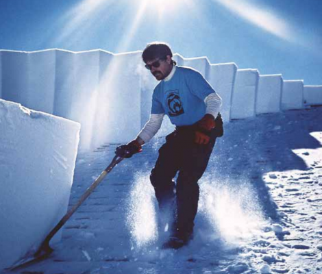 Winterkeeper for Yellowstone General Stores for the last 41 years, Jeff Henry in an action shot removing gigantic blocks of snow from the roof of the Canyon General Store in 1999. PHOTO COURTESY JEFF HENRY