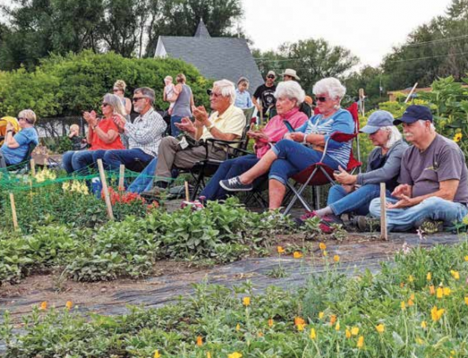 The community met in the garden for the first Thursday night concert and market held in July. Three more will be held this summer. PHOTO COURTESY MELISSA SMITH