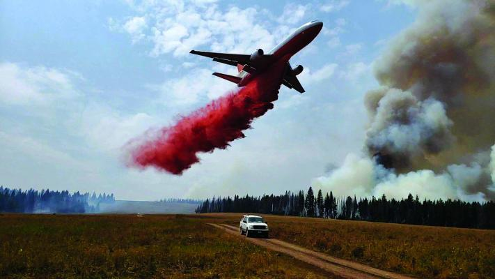 A very large air tanker (VLAT) drops flame retardant on the edges of the Wigwam Fire on Thursday, August 16. (USFS photo)