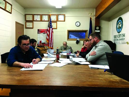 Twin Bridges town council members look over Great West Engineering plans for the town's storm water project sidewalk plans. Some property owners impacted by the plans tried to stymie the project, but failed. (J. Taylor photos)