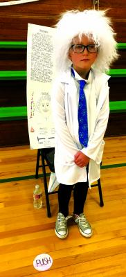 Albert Einstein (Harper Leonard) was one of the historical figures who visited Ennis 4th grade's wax museum project.