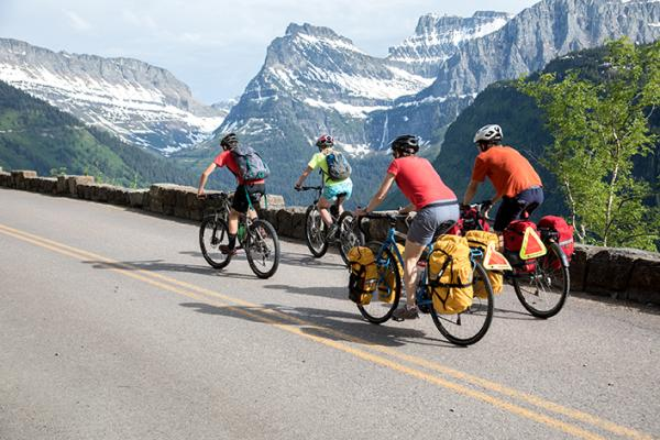 A group of touring cyclists pedals through Glacier National Park. The TransAmerica Trail, a popular touring route, runs coast-to-coast and passes through the Madison and Ruby valleys. (Tom Robertson/Adventure Cycling Association)