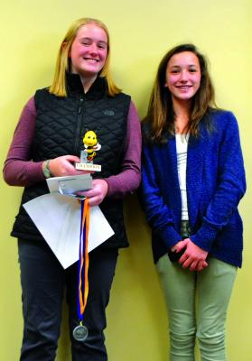 Harrison 8th-grader Dana Lerum (left) and Twin Bridges 6th-grader Allie Dale (right) were winner and runner-up, in the Madison County spelling bee on Monday, March 4. (R. Colyer)
