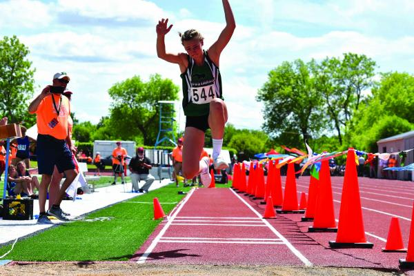 Jourdain Klein competes in triple jump at the MHSA state track and field championships in Great Falls on May 26. (Submitted)