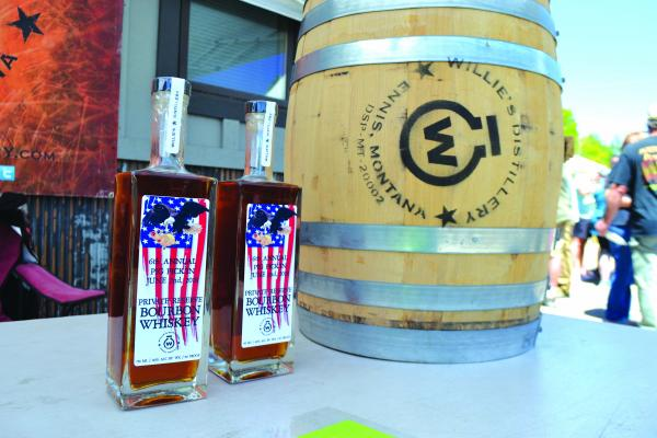 Willie's Distillery supplied commemorative, limited-edition bottles of their reserve bourbon and an (empty) 10-gallon whiskey barrel as prizes during their 6th annual Pig Pickin' on Saturday, June 2.