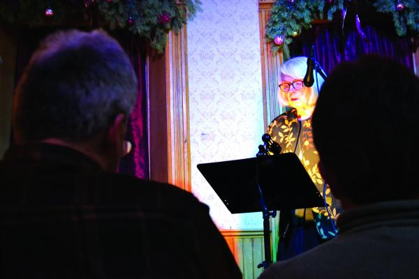 Tina James performed two original poems for a crowd of nearly 40 people at the Elling House's first Chautauqua of the season on Saturday, January 19. (R. Colyer photos) BELOW –