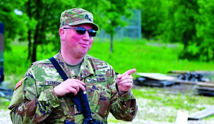 Virgina City-based Staff Sgt. Christopher Sturgill, a sheriff's deputy with the Madison County Sheriff's Office wears both Army green and police blue... well, tan and brown actually.  (Sumbitted)