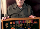 Hugh Z. Reynolds with Medals & Ribbons, including a Purple Heart and Bronze Star. (Submitted)