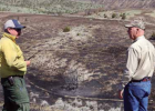 Gov. Gianforte (r) and Cory Calnan (l), county coop program manager for the DNRC, survey the Willow Creek Fire site on June 11. PHOTO COURTESY OFFICE OF THE GOVERNOR