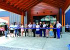 Officials, supporters and administrators of Ruby Valley Medical Center cut the ribbon opening the new hospital. Left to right: Ruby Valley Healthcare Foundation president Les Gilman, Tiger Munson, Steve Langlas, Jason Davis, Katie Hall, Dr. Warren Swager, John Benedict,Steve Troendle, Carol Braach, Ken Walsh, Tony Simonsen, Rev. Janis Hansen, Jenna Rhoads, Bob Olsen and John Semingson. (Submitted)