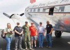 At Ennis-Big Sky Airport with Miss Montana. (L to R) Keely Flatow, Bill Drew, Shaun Raunig, Fred Raunig, Richard Raunig, Mike Farinelli. PHOTO BY BETSEY WELTNER
